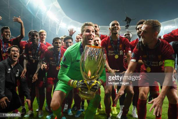 Adrian of Liverpool lifts the UEFA Super Cup trophy as Liverpool celebrates victory following the UEFA Super Cup match between Liverpool and Chelsea...