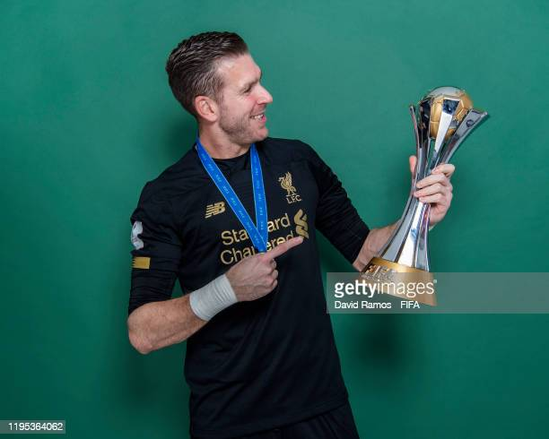Adrian of Liverpool poses with the Club World Cup trophy after the FIFA Club World Cup Qatar 2019 Final match between Liverpool and CR Flamengo at...
