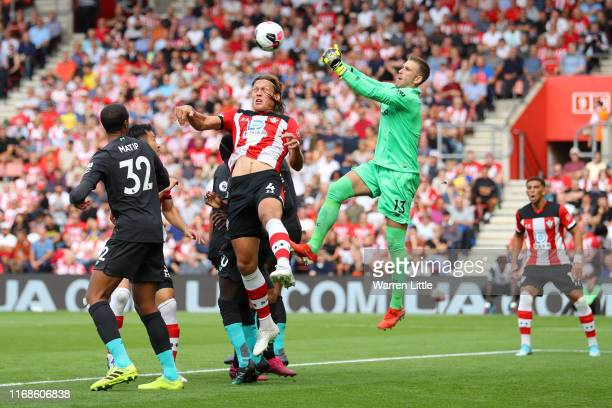 Adrian of Liverpool saves a shot from Jannik Vestergaard of Southampton during the Premier League match between Southampton FC and Liverpool FC at St...