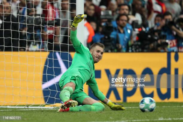 Adrian of Liverpool saves the winning penalty from Tammy Abraham of Chelsea during the UEFA Super Cup Final fixture between Liverpool and Chelsea at...