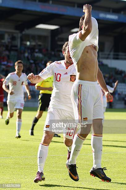 Adrian of Spain celebrates scoring his second goal as Juan Mata joins in during the UEFA European Under21 Championship Group B match between Czech...