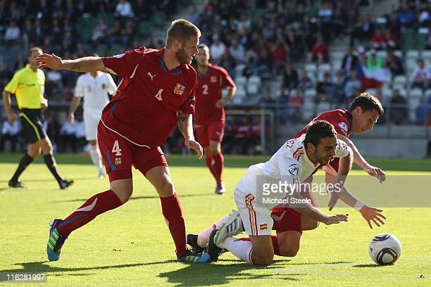 Adrian of Spain falls under the challenge of Marek Suchy as Ondrej Mazuch closes in during the UEFA European Under21 Championship Group B match...