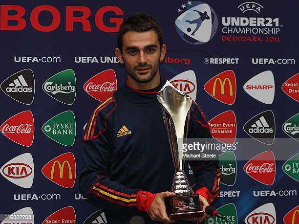 Adrian of Spain receives his Man of the Match trophy after the UEFA European Under21 Championship Group B match between Czech Republic and Spain at...