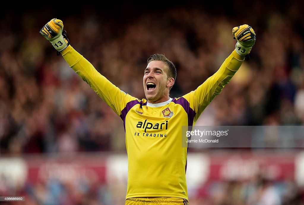 Adrian of West Ham celebrates after his team-mate Diafra Sakho scored their second goal during the Barclays Premier League match between West Ham United and Queens Park Rangers at Boleyn Ground on October 5, 2014 in London, England.