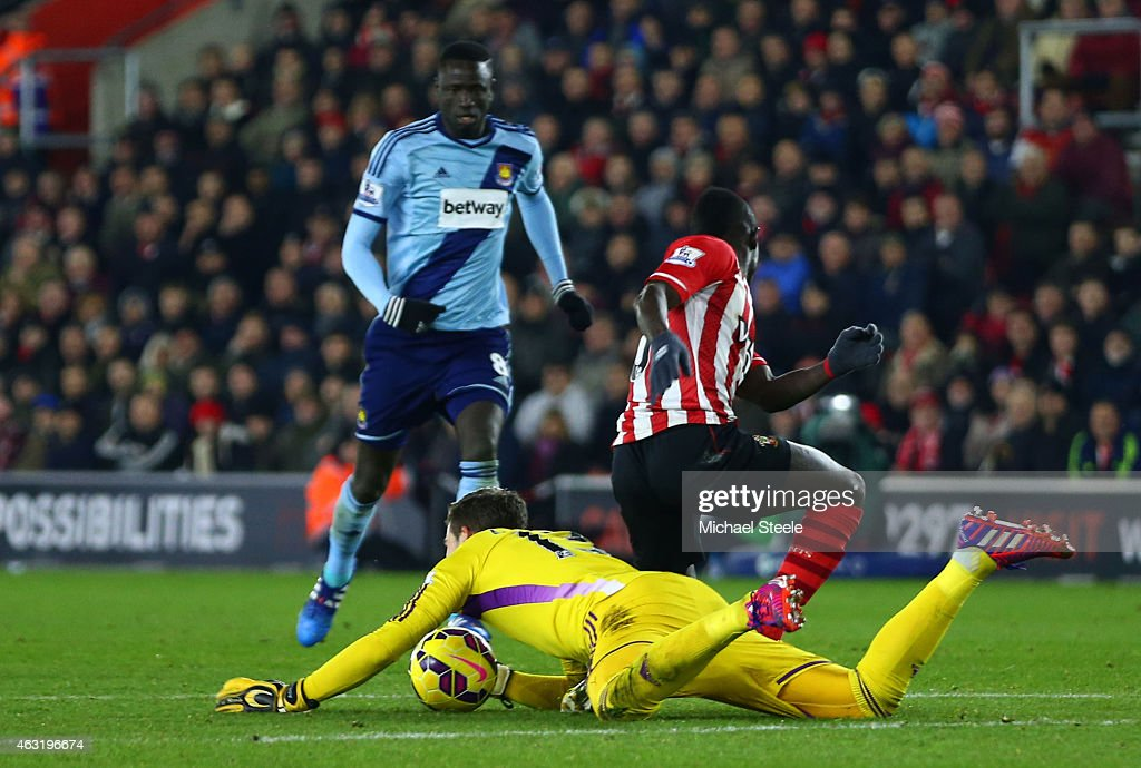 Adrian of West Ham dives on the ball outside of the area ahead of Sadio Mane of Southampton and subsequently receives a red card during the Barclays Premier League match between Southampton and West Ham United at St Mary's Stadium on February 11, 2015 in Southampton, England.