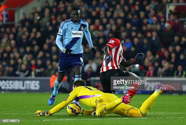 Adrian of West Ham dives on the ball outside of the area ahead of Sadio Mane of Southampton and subsequently receives a red card during the Barclays...