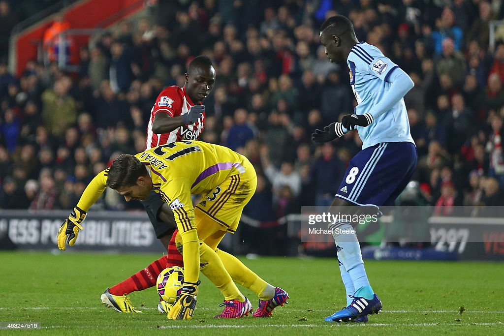 Adrian of West Ham handles the ball outside of the area as Sadio Mane of Southampton challenges and subsequently receives a red card during the Barclays Premier League match between Southampton and West Ham United at St Mary's Stadium on February 11, 2015 in Southampton, England.