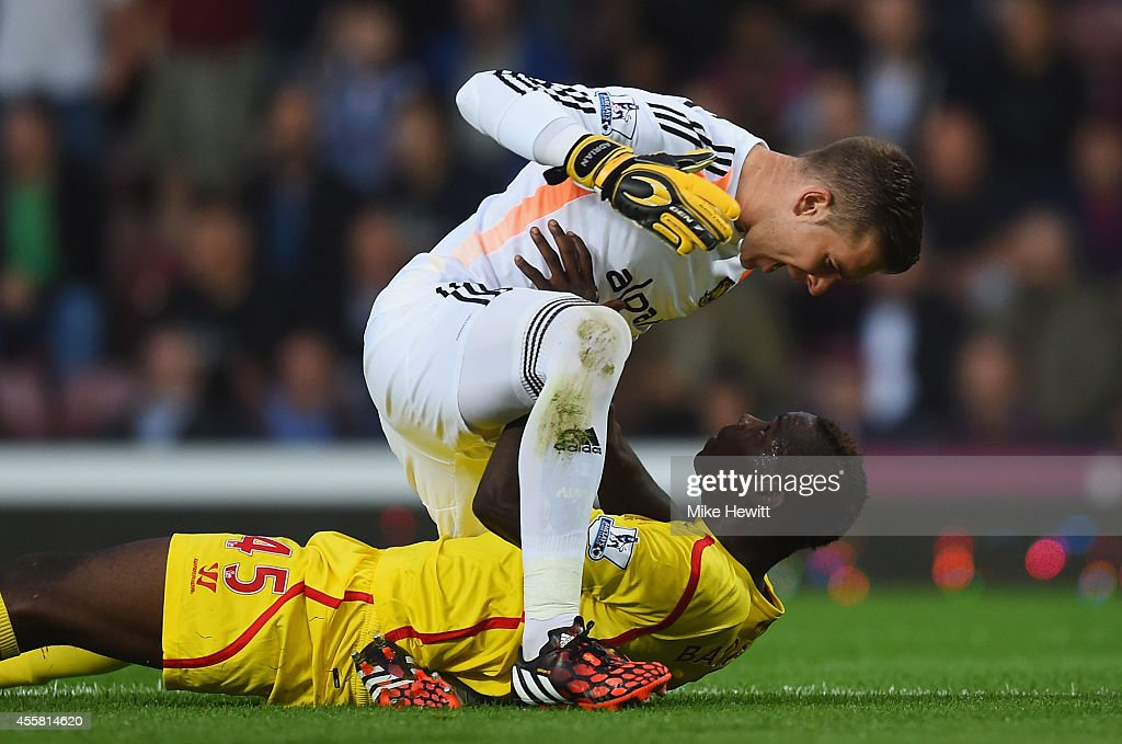 Adrian of West Ham has a disagreement with Mario Balotelli of Liverpool during the Barclays Premier League match between West Ham United and Liverpool at Boleyn Ground on September 20, 2014 in London, England.
