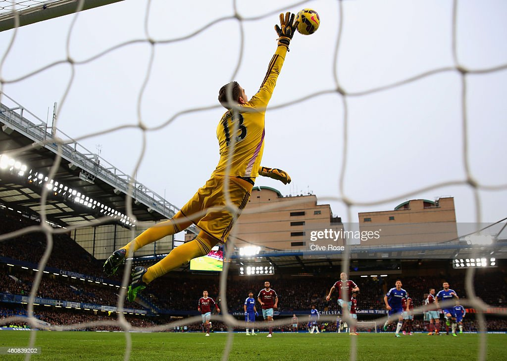 Adrian of West Ham makes a save during the Barclays Premier League match between Chelsea and West Ham United at Stamford Bridge on December 26, 2014 in London, England.
