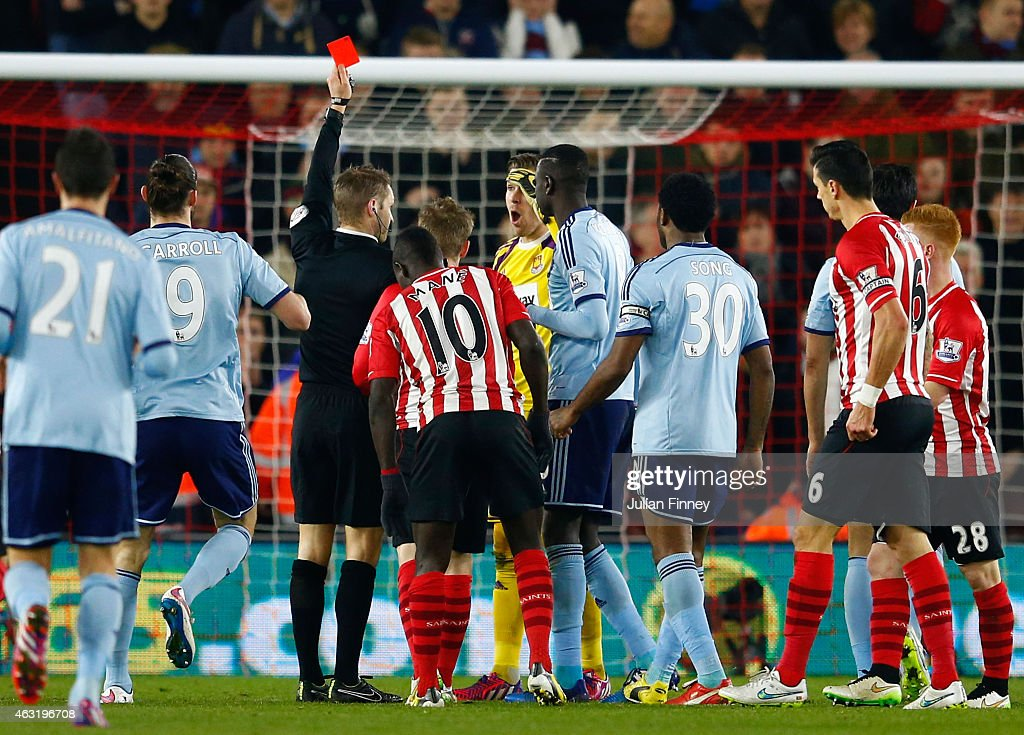 Adrian of West Ham receives a red card from referee Craig Pawson after diving on the ball outside of the area ahead of Sadio Mane of Southampton during the Barclays Premier League match between Southampton and West Ham United at St Mary's Stadium on February 11, 2015 in Southampton, England.