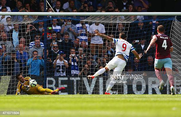 Adrian of West Ham saves a penalty from Charlie Austin of QPR during the Barclays Premier League match between Queens Park Rangers and West Ham...