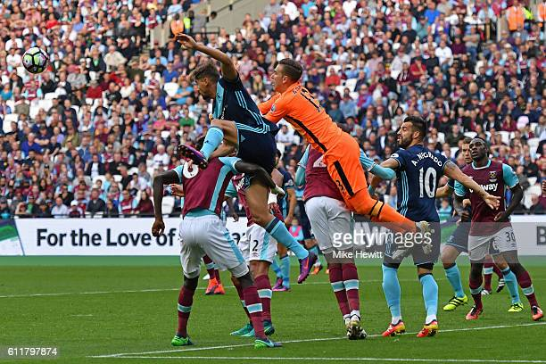 Adrian of West Ham United attempts to punch the ball during the Premier League match between West Ham United and Middlesbrough at London Stadium on...