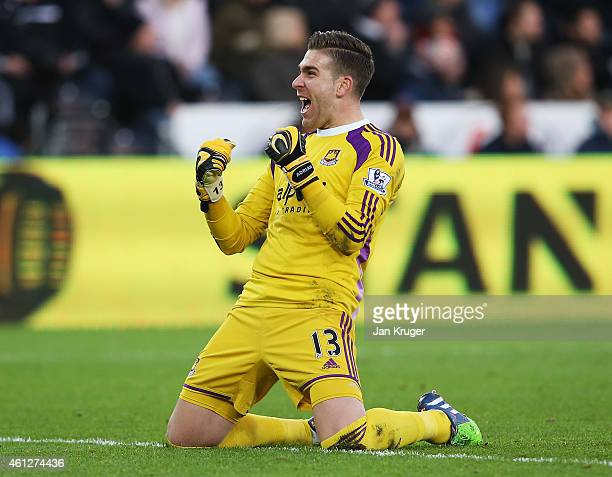 Adrian of West Ham United celebrates the opening goal scored by Andy Carroll during the Barclays Premier League match between Swansea City and West...