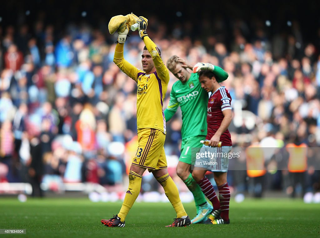 Adrian of West Ham United celebrates victory as Joe Hart of Manchester City is consoled by Mark Noble of West Ham United after the Barclays Premier League match between West Ham United and Manchester City at Boleyn Ground on October 25, 2014 in London, England.