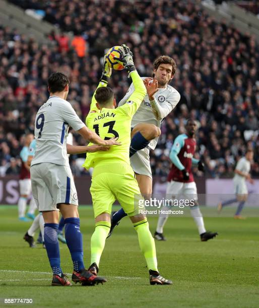Adrian of West Ham United collects the ball while under pressure from Marcos Alonso of Chelsea during the Premier League match between West Ham...