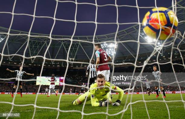 Adrian of West Ham United looks back as Mohamed Diame of Newcastle United scores his sides second goal during the Premier League match between West...