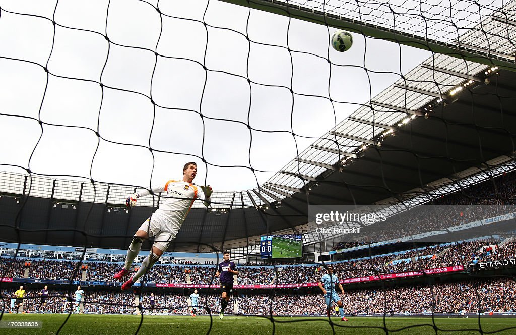 Adrian of West Ham watches as James collins of West Ham scores an own goal during the Barclays Premier League match between Manchester City and West Ham United at Etihad Stadium on April 19, 2015 in Manchester, England.
