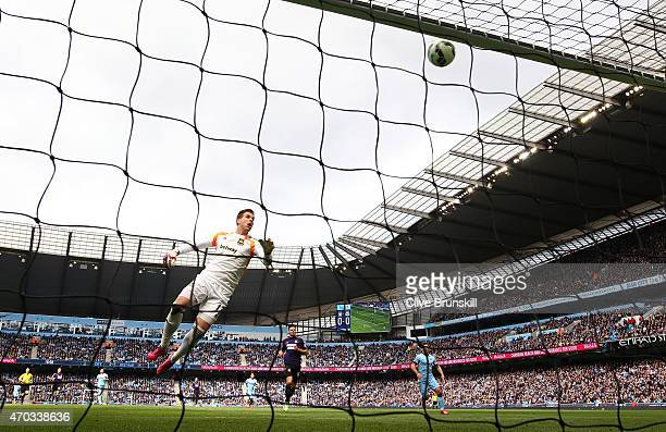 Adrian of West Ham watches as James collins of West Ham scores an own goal during the Barclays Premier League match between Manchester City and West...