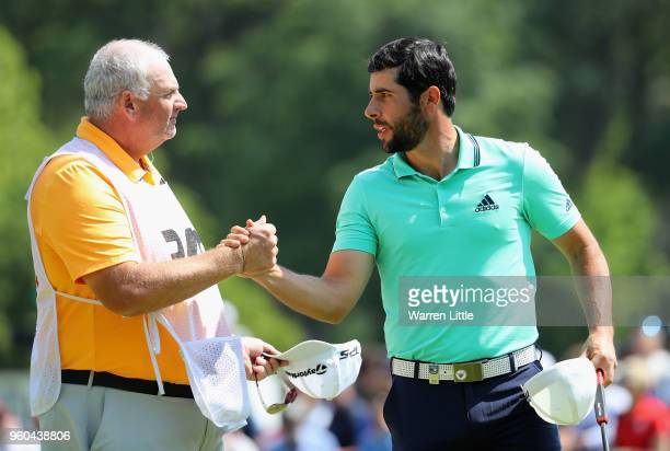 Adrian Otaegui of Spain celebrates with his caddy after winning his Semi Final match against David Drysdale of Scotland during the final day of the...