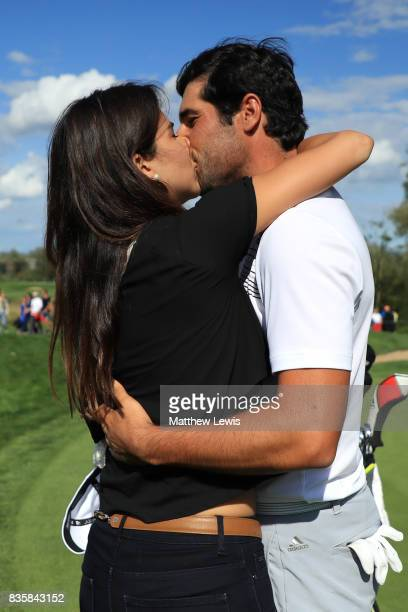 Adrian Otaegui of Spain celebrates with his girlfriend following his victory over Marcel Siem of Germany during the final match of the Saltire Energy...