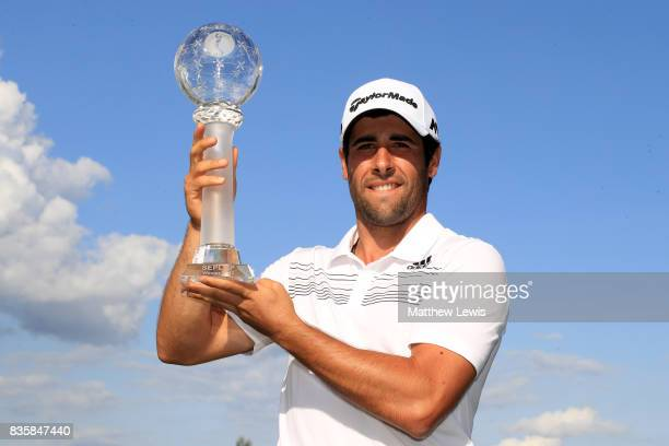 Adrian Otaegui of Spain holds the trophy aloft following his victory over Marcel Siem of Germany during the final match of the Saltire Energy Paul...