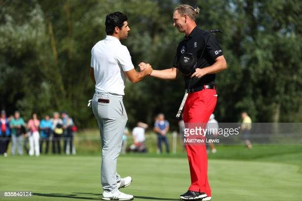 Adrian Otaegui of Spain is congratulated on his victory by Marcel Siem of Germany on the 17th green during the final match of the Saltire Energy Paul...
