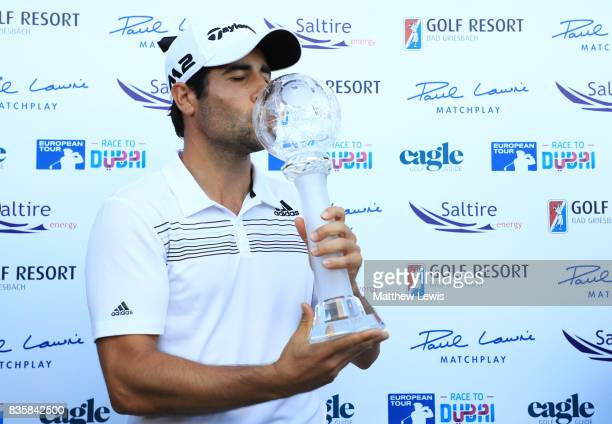 Adrian Otaegui of Spain kisses the trophy following his victory over Marcel Siem of Germany during the final match of the Saltire Energy Paul Lawrie...