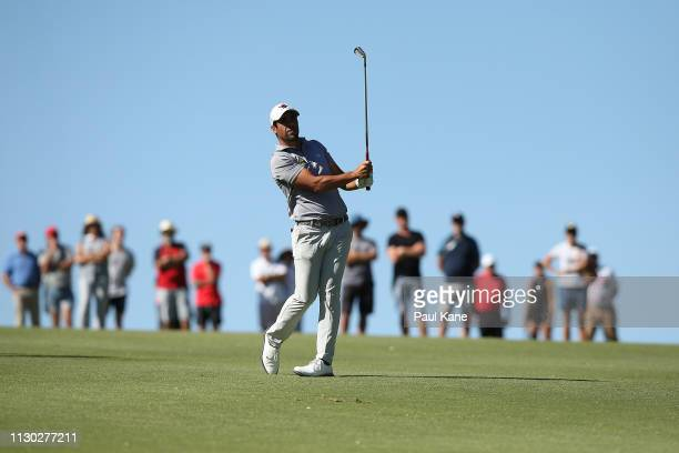 Adrian Otaegui of Spain plays his approach shot on the 3rd hole in the final against Ryan Fox of New Zealand during day 4 of the ISPS Handa World...