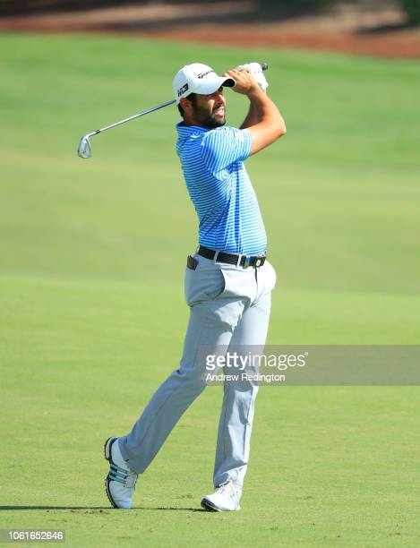 Adrian Otaegui of Spain plays his second shot on the 8th hole during day one of the DP World Tour Championship at Jumeirah Golf Estates on November...