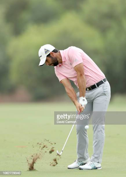 Adrian Otaegui of Spain plays his second shot on the par 4 third hole during the third round of the DP World Tour Championship on the Earth Course at...