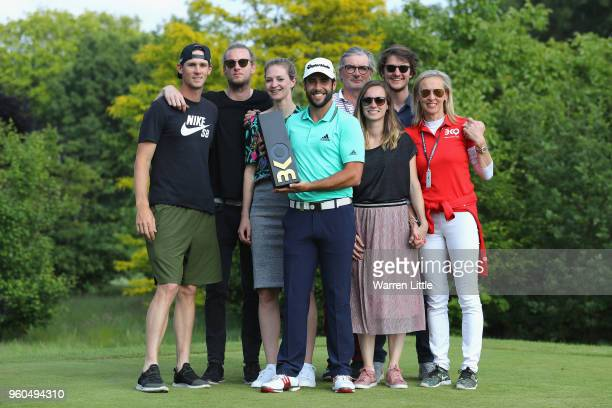 Adrian Otaegui of Spain poses with members of the Pieters production after beating Benjamin Hebert during their final match to win the tournament on...