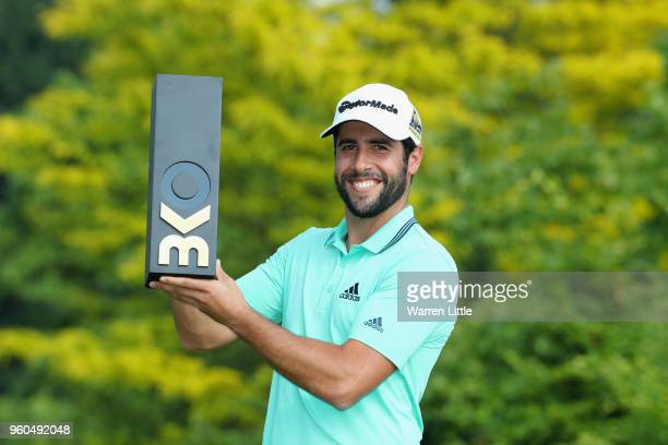 Adrian Otaegui of Spain poses with the trophy after beating Benjamin Hebert during their final match to win the tournament on the final day of the...