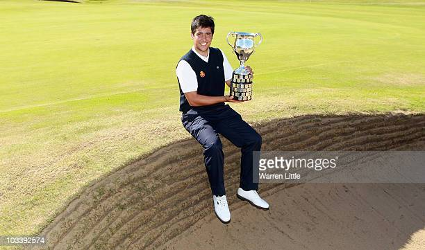 Adrian Otaegui of Spain poses with the trophy after beating Max Rottluff of Germany 43 to win the Boys Amateur Championship at the Kilmarnock Golf...