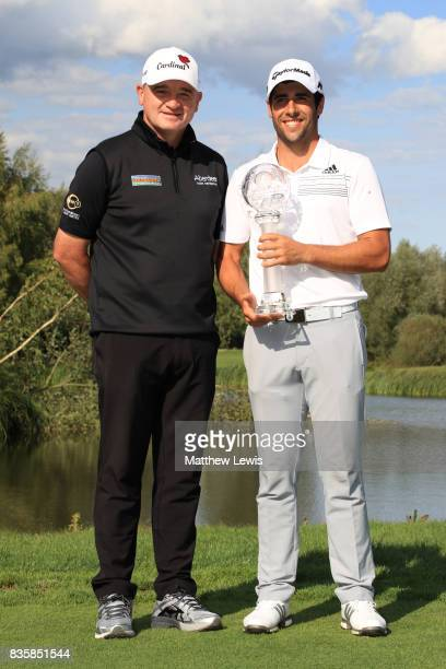 Adrian Otaegui of Spain poses with the trophy and Paul Lawrie of Scotland following his victory over Marcel Siem of Germany during the final match of...