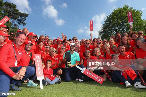 Adrian Otaegui of Spain poses with the trophy and the volunteers after beating Benjamin Hebert during their final match to win the tournament on the...