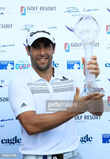 Adrian Otaegui of Spain poses with the trophy following his victory over Marcel Siem of Germany during the final match of the Saltire Energy Paul...