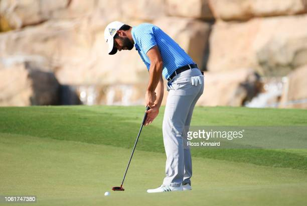 Adrian Otaegui of Spain putts on the 18th green during day one of the DP World Tour Championship at Jumeirah Golf Estates on November 15 2018 in...