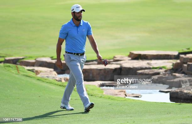 Adrian Otaegui of Spain walks to the 18th green during day one of the DP World Tour Championship at Jumeirah Golf Estates on November 15 2018 in...