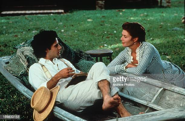 Adrian Pasdar sits in a boat and talks to Kelly McGillis in a scene from the film 'Grand Isle', 1991.