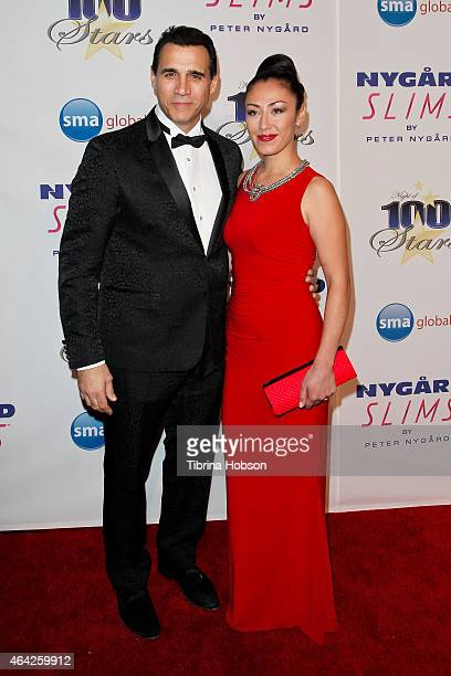 Adrian Paul and Alexandra Tonelli attend the Norby Walters 25th annual night of 100 stars Oscar viewing gala at The Beverly Hilton Hotel on February...