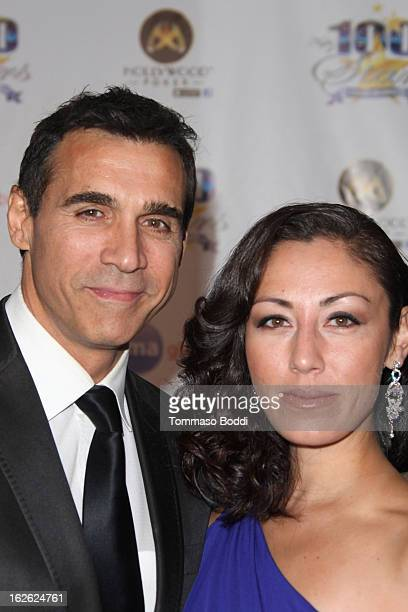 Adrian Paul and guest attend the 23rd annual Night Of 100 Stars black tie dinner viewing gala held at the Beverly Hills Hotel on February 24 2013 in...