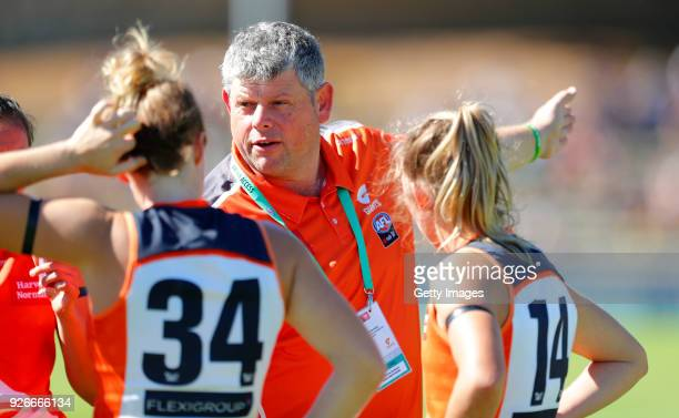 Adrian Pavese talks to his players during 3 quarter time during the round five AFLW match between the Fremantle Dockers and the Greater Western...
