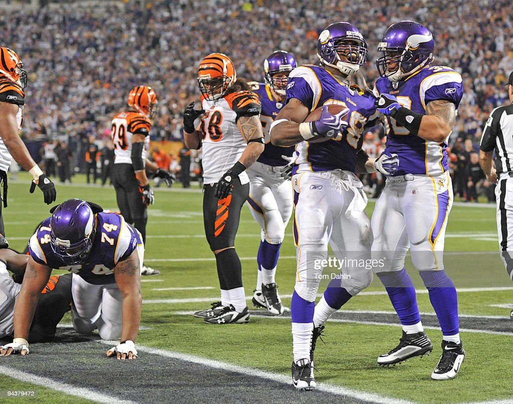 Adrian Peterson #28 and Naufahu Tahi #38 of the Minnesota Vikings celebrate following a touchdown during an NFL game against the Cincinnati Bengals at the Mall of America Field at Hubert H. Humphrey Metrodome, December 13, 2009 in Minneapolis, Minnesota.