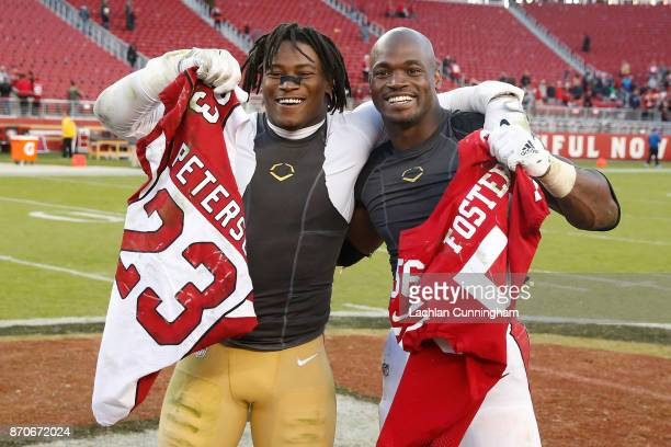 Adrian Peterson of the Arizona Cardinals and Reuben Foster of the San Francisco 49ers trade jerseys after their NFL game at Levi's Stadium on...