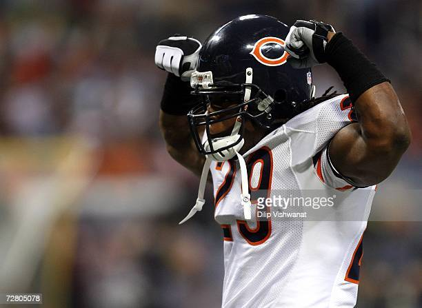 Adrian Peterson of the Chicago Bears flexs his muscles after making a play against the St Louis Rams at the Edward Jones Dome on December 11 2006 in...