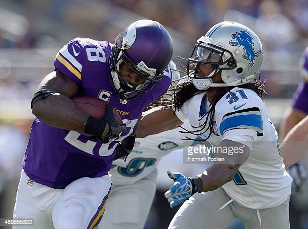 Adrian Peterson of the Minnesota Vikings carries the ball against Rashean Mathis of the Detroit Lions during the fourth quarter of the game on...