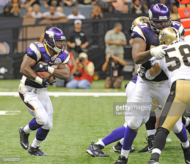 Adrian Peterson of the Minnesota Vikings carries the ball during an NFL game against the New Orleans Saints at Louisiana Superdome on September 9...