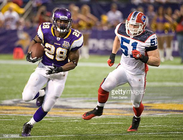 Adrian Peterson of the Minnesota Vikings carries the ball during an NFL game against the Buffalo Bills at Mall of America Field at the Hubert H...