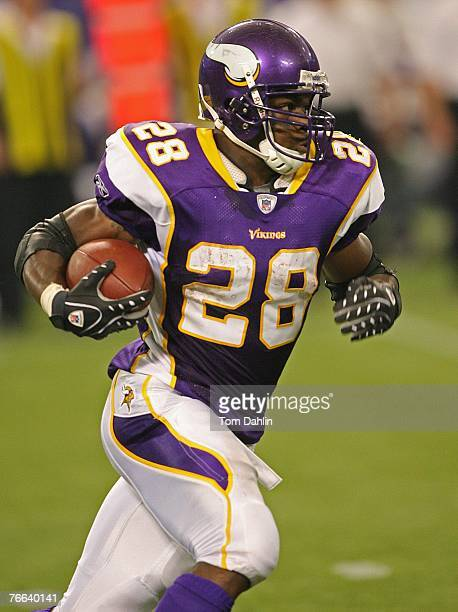 Adrian Peterson of the Minnesota Vikings carries the ball during an NFL game against the Atlanta Falcons at the Hubert H Humphrey Metrodome September...