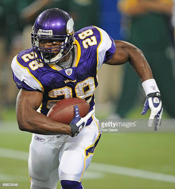 Adrian Peterson of the Minnesota Vikings carries the ball during an NFL game against the Green Bay Packers at the Hubert H. Humphrey Metrodome, on...